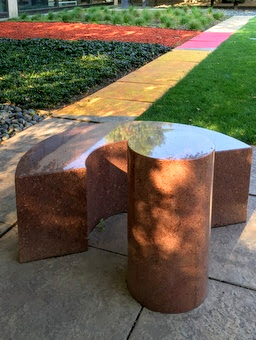 Image of Scott Burton's Bench and Table sculpture in the Smart Museum garden