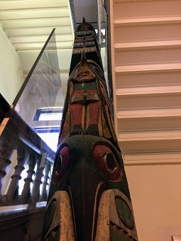 Image of top half of the totem pole in Haskell Hall