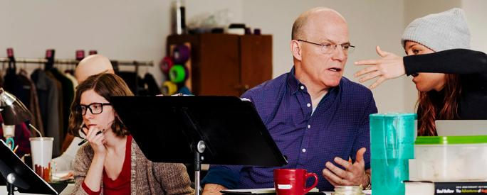 Charles Newell, center, is directing the production at the Court Theater.CreditWhitten Sabbatini for The New York Times