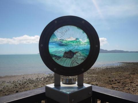 A damaged public art installation in Townsville looking onto Magnetic Island.