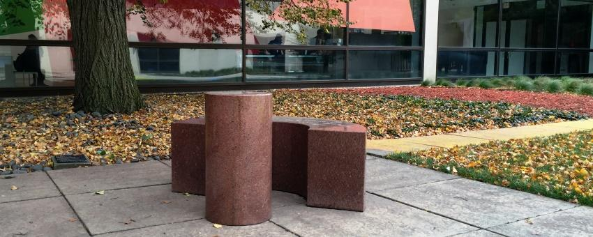 Image of Scott Burton's Bench and Table with Smart Museum in background
