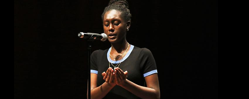 Student poet performs as part of The New Speak open mic