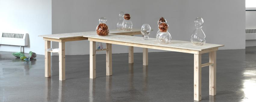 Glass vessels on wooden table