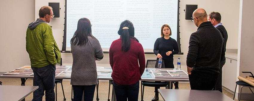 Joo Young Lee (MFA candidate, Sculpture, SAIC), Mirae Lee (PhD student, Microbiology, UChicago), and Maggie Zhang (PhD student, Microbiology, UChicago) during a critique of their project, Invisible/Invincible: The Bacteria Survival Guide (2017–18).