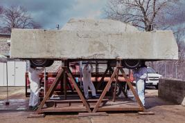 Image of Concrete Traffic sculpture lifted on sawhorses for conservation