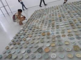 At a Beijing gallery, a student contemplates a work by Chinese artist He Xiangyu. (Photo by Laura Letinsky)