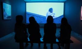 Visitors view the work of Lauren Beck