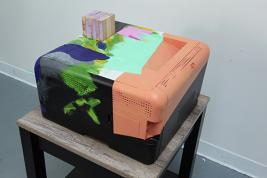 Jessica Stockholder, Keeping abreast, 2017, Black printer, wooden block made of Jenga blocks, oil paint, adhesive.