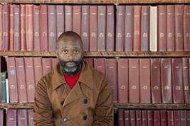 Theaster Gates with the Ebony archive in Chicago (Photo: Sara Pooley)